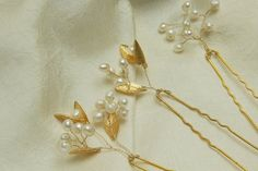 Bridal Hair Pins - Handcrafted with lustrous white freshwater Keshi pearls, gold plated leaf charms and gold wire. Available in three different pin designs. Mix and match to suit your individual style.