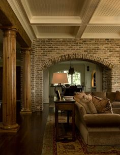 Living Rooom with Natural Fluted Columns and Segmental Brick Arch traditional living room