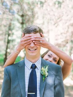 Amp up the anticipation with a playful and romantic first look by having the bride place her hands over the groom's eyes before revealing herself.