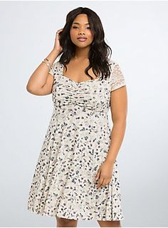 """<p>The human world can be a mess, but sometimes we get things right! Like this dress for instance. The stretchy ivory knit skater style sports an under-the-sea themed Ariel print. A cinched bodice and cutout back flash some skin, the lace inset is totally """"kiss the girl"""" worthy.</p>  <p></p>  <p><b>Model is 5'11"""", size 1</b></p>  <ul> <li>Size 1 measures 41"""" from shoulder</li> <li>Polyester/rayon</li> <li>Wash cold, dry low</li> <li>Imported plus size dre..."""