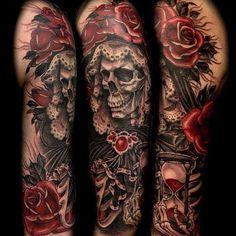 Arm sleeve tattoo. Skeleton, rose and sand hourglass.