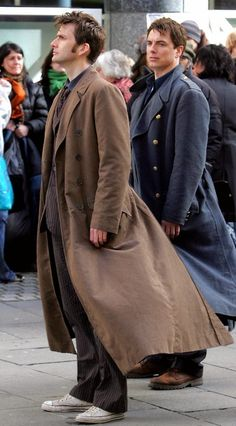 "Let me just say that when I had a trench coat in middle school, it was ""stupid,"" but by god, if David Tennant and John Barrowman can't make them look ""COOL..."""