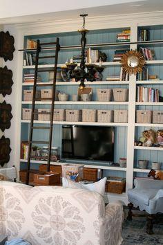 Livingroom - 1/2 wall of shelves - open to kitcen
