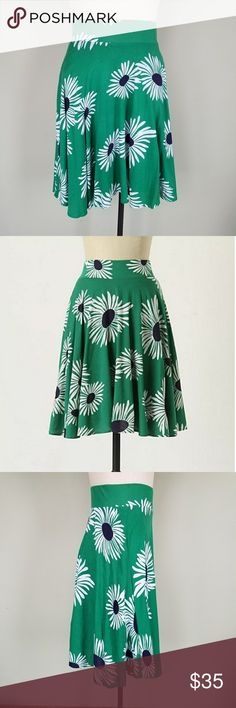 """Anthropologie Ric Rac Daisy Gaillardia Skirt Ric Rac by Anthropologie. Women's XS. Gaillardia Skirt / Circle Skirt.  Kelly green, white, and navy blue daisy pattern. High waisted thick elastic waistband. 100% Cotton fabric. Fully lined.  Excellent condition! Waist- 12.75"""" Length- 22.75"""" Anthropologie Skirts"""