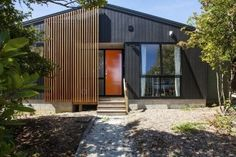 Box™ is an NZIA architectural practice & Registered Master Builder. Check out some of our most inspiring designs and outstanding build projects. New Zealand Architecture, Architecture Plan, Exterior Cladding, Exterior Houses, House Exteriors, Modern Shed, Modern Entrance, Shed Homes, Tiny Homes