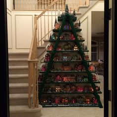 Cool! Cannot locate the original source, although its received thousands of likes on Facebook. Here is a source for a scaled down version. http://countryandvictoriantimes.com/2014/12/20/christmas-tree-decorating-idea-ladder-display-shelf/