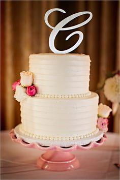 elegant white wedding cake #weddingcake #elegantcake #weddingchicks http://www.weddingchicks.com/2014/03/04/funky-seaside-wedding/