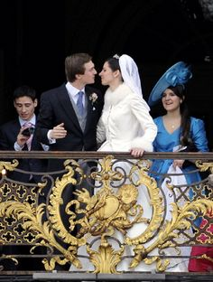 Archduchess Adelaide Drape-Frisch (3rd R) and archduke Christoph of Austria (2nd L) kiss on the balcony of the Nancy tonwnhall, on 29  Dec 2012, in Nancy