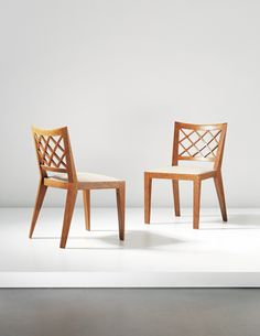 Jean Royère, Pair of 'Croisillon' dining chairs