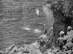Desperation: Saipan civilians commit suicide rather than surrendering to American troops. Around 1,000 civilians perished this way, , jumping from 'Suicide Cliff' or 'Banzai Cliff' after propaganda led them to fear occupation under Americans.