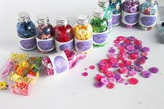 Buttons, sequins, and more - in EVERY color - are packed inside these adorable @buttonsgalore 28 Lilac Lane decorative embellishment bottles and kits. Great space savers AND fun to look at while you're creating! (link in profile) #scrapbookcom