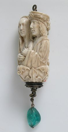 Rosary Termainal Bead with Lovers and Death's Head, ca. 1500–1525 Made in, North France or South Netherlands Culture: North French or South Netherlandish Ivory, with emerald pendant, silver-gilt mount