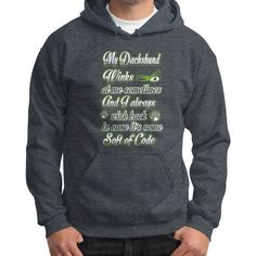 My Dachshund winks at me sometimes and I always wink back in case It's some soft of code Gildan Hoodie (on man)