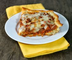 Deep Dish Sloppy Joe Casserole - pizza crust filled with rich saucy meat and veggies and topped with melty cheese. Just 356 calories or 9 Weight Watchers SmartPoints for a big serving! Lots of hidden vegetables. www.emilybites.com