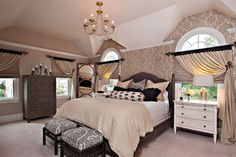 Beautiful bedroom and I love the windows and window treatment.