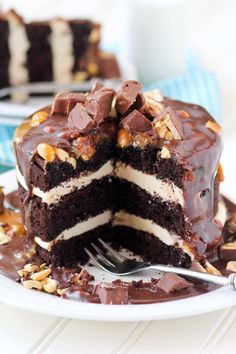Snickers Layer Cake is completely irresistible. Just check out that caramel and chocolate oozing over the sides!