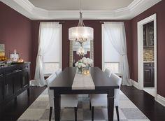 Benjamin Moore Paint Colors - Red Dining Room Ideas - Pretty, Polished Red Dining Room - Paint Color Schemes . . . . . Deep raisin red creates texture and timeless elegance in the dining room. . . . . . Walls - Hodley Red (HC-65); Ceiling - Grége Avenue (991); Trim - Steam (AF-15).