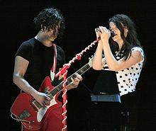 The White Stripes-- were an American rock duo formed in 1997 in Detroit, Michigan. The group consisted of Jack White (songwriter, vocals, guitar, piano, and mandolin) and Meg White (drums and vocals). After releasing several singles and three albums within the Detroit music scene, The White Stripes rose to prominence in 2002, as part of the garage rock revival scene. Their successful and critically acclaimed albums White Blood Cells and Elephant drew attention from a large variety of