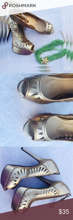 Gold Qupid Heels Standout with these gorgeous but it shows by Qupid . Color is gold but not towards the bright side . More of cop perish . Heels 5.5' with 1.5' of platform . Qupid Shoes Platforms