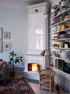 In this equally chic and cozyScandinavian living room, a fully functioning wooden stove is the focal point of the design. Home Interior, Interior Architecture, Interior Decorating, Interior Design, Fireplace Bookshelves, Deco Boheme, Winter Home Decor, Living Spaces, Living Room