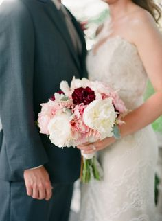 White Peonies, Dusty Miller, pink Cymbidium Orchids and Astilbe accented with a pop of burgandy Dahlias is such a great combination