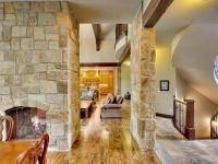 Aspen Ridge I Hallway and View of Two Way Fireplace from Dining Room and Hearthrooom