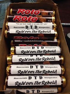 "Week 3 Treat - Love this! Rolos were 80 cents at Dollar General. Made labels with address labels. Downloaded cute font called ""Chocolatier"" from Fontspace.com and used the phrase ""ROLO'ver the Rebels"" EASY!! #footballmom"
