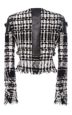 This **Alexander Wang** jacket features a graphic boucle tweed construction with a boxy cropped fit.