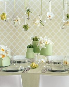 """Setting vivid (and long-lasting) orchids against spring-green fondant-covered tiers results in a look that's fresh and utterly modern. There are hundreds of orchids to choose from; we used (from left) cattleya, dendrobium, lady's slipper, and """"Japhet' cattleya."""
