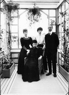 Alexandra; Dagmar; Alexandra's middle daughter, Princess Victoria; and Dagmar's youngest son, Grand Duke Michael in the garden room of their shared villa, Hvidøre, north of Copenhagen, Denmark, 1908.