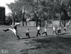 Pied Piper of Ann Arbor: Photo by Alfred Eisenstaedt, 1950    A uniformed drum major for the University of Michigan marching band practices his high kicks, garnering an unintended following of seven admiring children who want to imitate his flamboyant technique. Eisie's joyously cheerful 1950 photo is like a Norman Rockwell painting come to life.