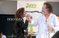 Guest star Kenny G and Alexander Zonjic congratulate one another after finishing another song during their headlining performance at the River Raisin Jazz Festival in 2011. Photo by Kim Brent for The Monroe Evening News.