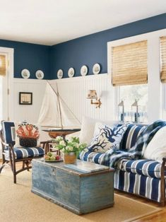 Blue and white bech house style living room with stripes and fun details like crab pillow #coastallivingroomsbeach #whitecoastallivingrooms