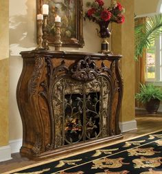 "Royal Crest Fireplace (W71½"" D19"" H51½"")Notice the curves and intricate carvings along with the swing-metal gate and its elegant climbing vines. Together with the electric faux-fire insert, you'll find yourself in cozy elegance."