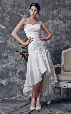 This trendy high-low wedding dress keeps elements of a classic gown like a strapless sweetheart neckline, sheath silhouette and shiny satin.  Pleats emphasize the form-fitting bodice, while ruffles cascade along the hemline of the skirt, creating a contrasting but cohesive appearance.FEATURESSatinSheath, Sweetheart Neck, Natural Waist, StraplessPleats, RufflesFully Lined, Dry Clean Only, ZipperWedding Dress