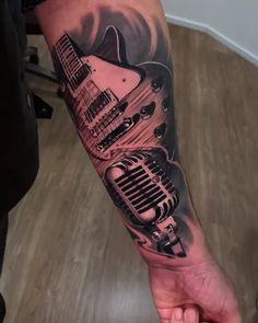 Tatuagem de guitarra e microfone no estilo preto e cinza criada pelo artista brasileiro Wallace Farias. Belly Tattoos, Car Tattoos, Music Tattoos, Tattoos For Guys, Music Tattoo Sleeves, Arm Sleeve Tattoos, Leg Tattoo Men, Compass Tattoo Design, Music Tattoo Designs