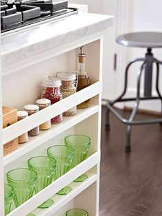Trick #9: Add storage where you can find it. In the kitchen, a 4-inch filler piece of cabinetry by the range is a spice and glass rack.