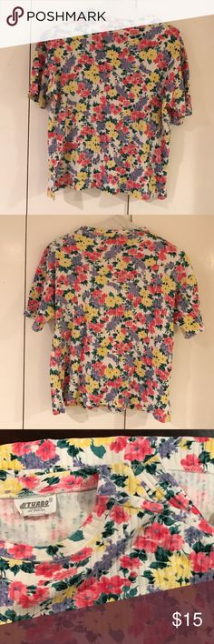 Vintage Ribbed Floral Top Colorful short sleeve ribbed floral top would be great on its own or under a jacket for a punch of color. Side slits to fall nicely and flatter. Tag says one size, but I'm calling Large based on measurements-please check photos. No stains or flaws. Turbo Tops