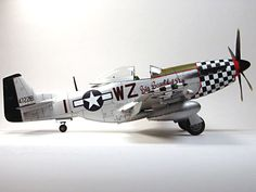"Model Airplane | Professionally built 1/48 scale Tamiya model of a North American P-51D Mustang ""Big Beautiful Doll""."