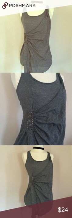 """NWT Guess Draped Studded Grey Tank S Fall Fashion Brand new, with tags from Bloomingdales, charcoal grey tank by Guess. Tank is draped in a Grecian style, and is adorned with grey studs and beading. Made of cotton and rayon, this tank is super soft and great for layering. Tagged a size small and measures: 36"""" across the chest, 28"""" length from shoulder to hem. Guess Tops Tank Tops"""