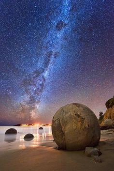 The Milky Way photographed over the Moeraki Boulders, New Zealand.