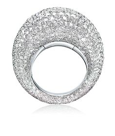 Cellini Jewelers white diamond Dome ring. Composed of 7.72 carats of diamonds and is set in 18 karat white gold. Not only is the design extremely wearable, but this ring features an inner mechanism for automatic sizing allowing for a comfortable fit ranging four sizes.