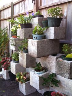 Make a wall with cinder blocks & use potted plants to decorate!