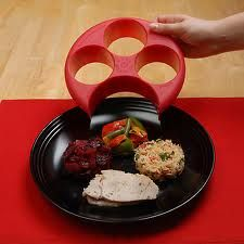 """There are 4 portion control areas - 2 for fruits and veggies, 1 for starches and 1 for protein. A line in the middle of each cavity represents a half cup, with full cup measurements at the top. The bottom """"moon"""" shape is for protein, in which there is also a line to guide you in proper portioning of your protein. Simply place Meal Measure on your plate, fill to desired measurements depending on the meal / age, and lift up. Your portions are perfectly measured!"""