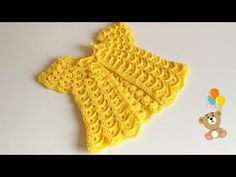Make this beautiful crochet baby dress for any special child in your life. Watch this free video tutorial to learn how to make this beautiful baby dress. Crochet Girls, Crochet Baby Clothes, Puff Stitch Crochet, Knit Crochet, Baby Hoodie, Tricot Simple, Knitting Patterns, Crochet Patterns, Pull Bebe