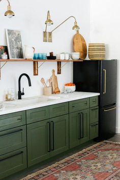 Last week we posted our studio kitchenette reveal and everyone had so many questions about our DIY black fridge with the brass pulls! When we started planning out our studio kitchen design we fell i Kitchenette Studio, Petite Kitchenette, Basement Kitchenette, Farmhouse Kitchen Decor, Diy Kitchen, Kitchen Ideas, Kitchen Storage, Olive Green Kitchen, Green Kitchen Decor