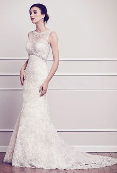 Kenneth Winston. See More Kenneth Winston Gowns��Sheer bateau neckline dressed with Alen�on lace from top to bottom. Carefully placed Swarovski crystals adorns the bodice as it wraps around ending at a low back sheer build up. Zipper back.