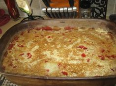 In a 9x13 inch pan, pour undrained crushed pineapple on the bottom. Next layer cherries, then coconut and then nuts. Sprinkle cake mix over entire cake. Do not mix. Melt butter and drizzle all over cake. Place in a 350F oven for 45 minutes. Serve with vanilla ice cream or cool whip.