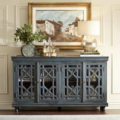 Birch Lane Fenton Sideboard | Inspired by an antique built-in cabinet found in a century-old home, our four-door sideboard offers an authentic, aged look. It features glass door fronts and fretwork accented by a handpainted finish in an aged green.