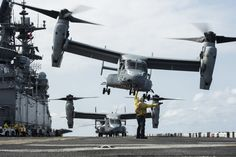 SOUTH CHINA SEA (April 12, 2017) Aviation Boatswain™s Mate (Handling) 2nd Class Leo Gonzales, from San Diego, signals for an MV-22B Osprey, assigned to the Ridge Runners of Marine Medium Tiltrotor Squadron (VMM) 163, to take off from the flight deck of the amphibious assault ship USS Makin Island (LHD 8). Makin Island, the flagship for the Makin Island Amphibious Ready Group, with the embarked 11th Marine Expeditionary Unit